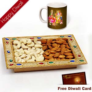 dryfruits in a tray with diwali wishes mug