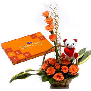 orange roses with teddy basket