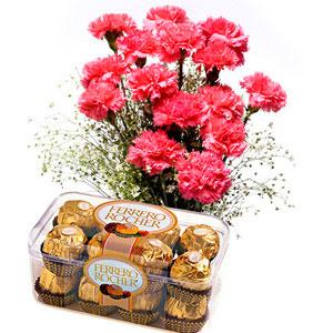 pink carnations ferrero roche basket