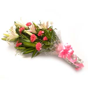 pink carnations pink lilies bouquet midnight