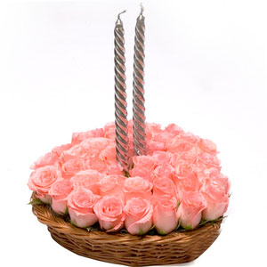 pink roses with candles basket