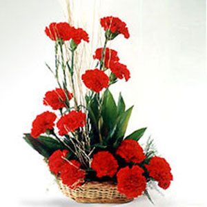 red carnations basket romantic affair